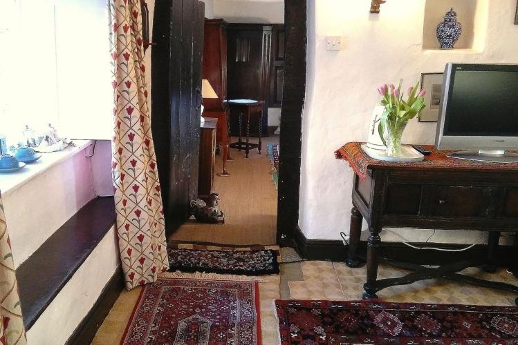 Johnby Hall B&B-sitting-room-through-to-bedroom